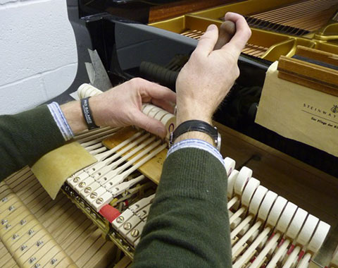 Hammers being fixed in piano restoration